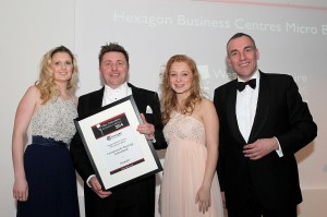 Brendan Cross of Hexagon Business Centres presents the award certificate to Micro Business Award finalists Community Buying Unlimited - Katy Cameron, Chris Pomfret & Faye Parker - at the West Oxfordshire Business Awards dinner at Heythrop Park Picture: Ric Mellis